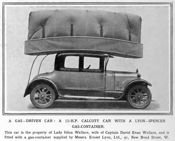 A rather unsafe looking gas- driven Calcott car with a huge Lyon-Spencer gas container on its roof drawfing the car itself. Owned by Lady Idina Wallace.Hope she didn't smoke