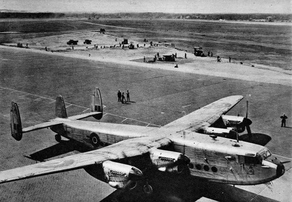 Photograph showing a 'York' transport airplane at Gatow Airport, during the 'Berlin Airlift', 1948. In the background of the image, extension work on the runway can be seen being undertaken. Between April 1948 and May 1949 Josef Stalin