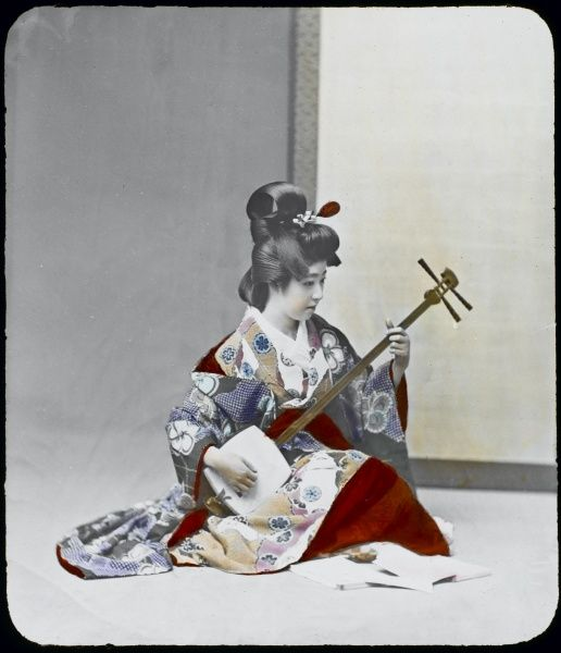 A young geisha practises on her shamisen