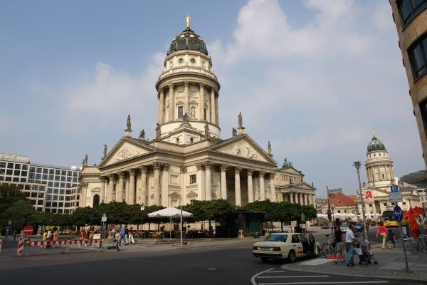 View of the Gendarmenmarkt in Berlin, with the German Cathedral at the centre, and the French Cathedral in the distance on the right