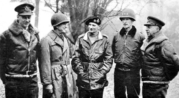Photograph showing (left to right) Lieut-General Sir Miles Dempsey, British Second Army; Lieut-General Hodges, US First Army; Field-Marshal Montgomery; Lieut-General Simpson, US Ninth Army; General Crerar, Canadian First Army, 1945
