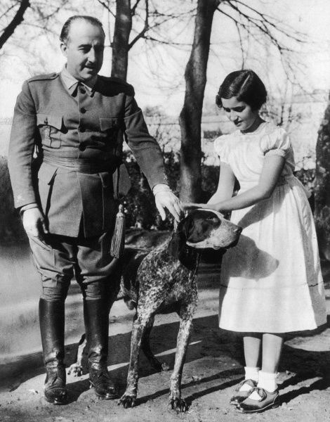 Photograph showing General Francisco Franco (1892-1975) and his daughter, Carmencita, with her dog, Dick, 1938. By 1938 Franco had become Leader of Nationalist Spain and his future, as Spanish Dictator, was assured