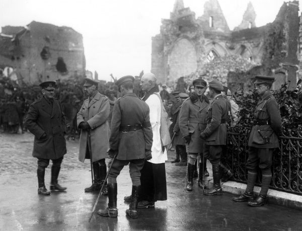 General Sir Henry Rawlinson (1864-1925), British army officer, seen here with other officers and an army chaplain in recaptured French territory in Peronne, northern France, awaiting the arrival of President Poincare