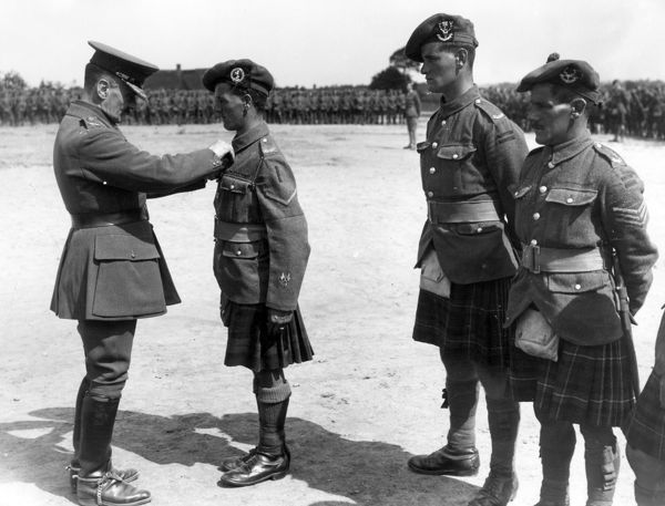 General Sir Ivor Maxse (1862-1958), British army officer during the First World War. Seen here presenting medals to men of the 152nd Brigade at Sint Jan-Ter-Biezen, Belgium. Date: August 1917