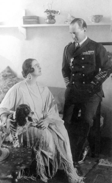King George II of the Hellenes (1890-1947) and his wife, Elisabetha (1894-1956) in the early 1920s. George was the eldest son of King Constantine I and Queen Sophie, and the elder brother of King Alexander. The couple married in 1921 and divorced in 1935
