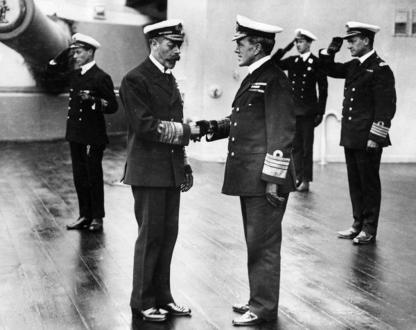 George V - King of England from 1910-1936 shaking hands with Admiral Frederick Charles Doveton Sturdee, 1st Baronet (1856-1925) who defeated the German, Admiral von Spee at the Battle of the Falkland Islands in 1914. He was promoted to Admiral in 1917