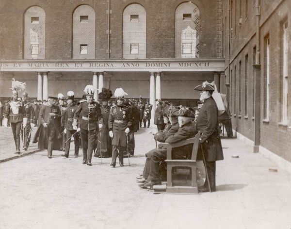 King George V visiting Chelsea Pensioners at the Royal Hospital, Chelsea, London. This visit may have coincided with the Royal International Horticultural Exhibition, which in 1912 was staged in the grounds of the Royal Hospital and visited by King George