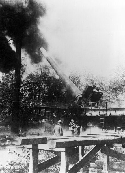 A German 38cm quick-loading rail-mounted long-range naval gun L/45 Max (nicknamed Langer Max, or Long Max), designed and manufactured by Krupp, in action on the Western Front during the First World War