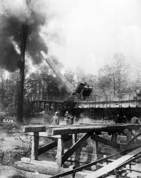 A German 38cm quick-loading rail-mounted naval gun L/45 Max (nicknamed Langer Max, or Long Max), designed and manufactured by Krupp, in action on the Western Front during the First World War