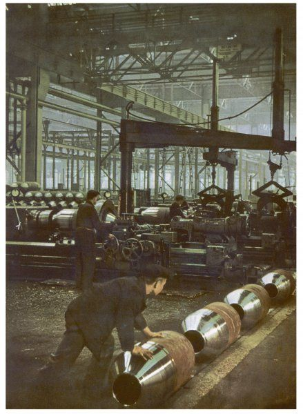 scene in a German munitions works, manufacturing shells for artillery