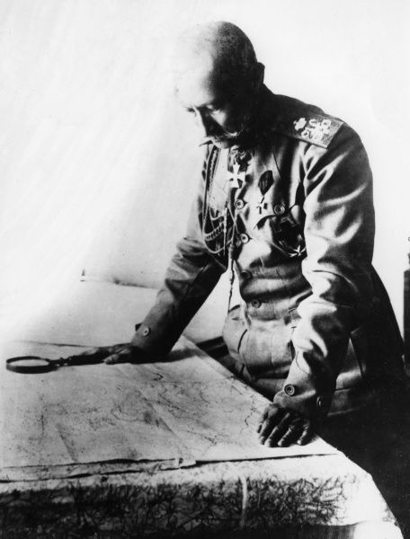 An unnamed German army officer examining a map during the First World War. Date: 1914-1918