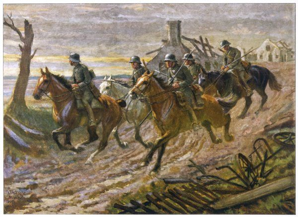 A German cavalry patrol ride through the ruins of a village