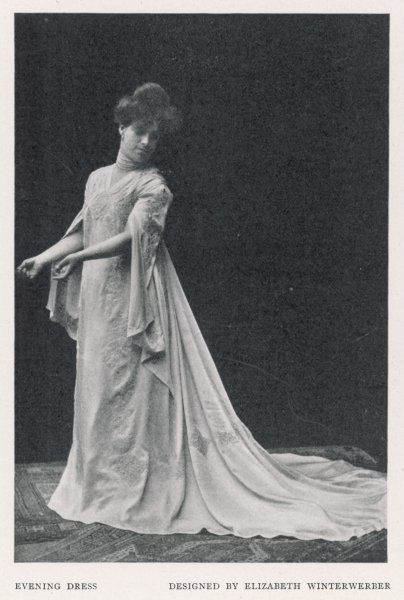 German 'New Artistic Reform Dress': design by Elizabeth Winterwerber. High waisted wrap-over gown with split sleeves, a flowing trained skirt & ornate embroidery