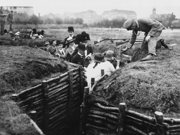 Germans from Berlin viewing dummy trenches and a dummy mine thrower in Germany during World War I