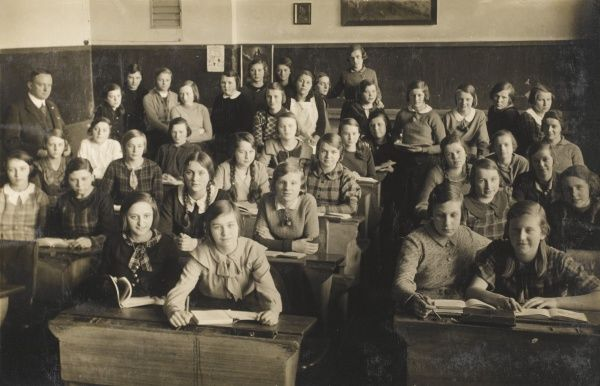 German schoolgirls in their classroom - apparently with a male teacher