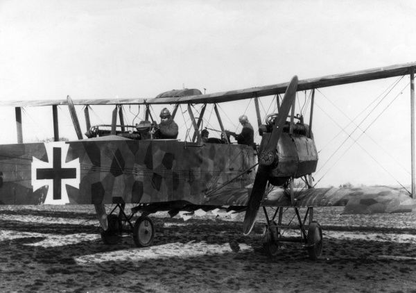 A German Gotha heavy bomber biplane, with crew, on an airfield during the First World War. Date: 1914-1918