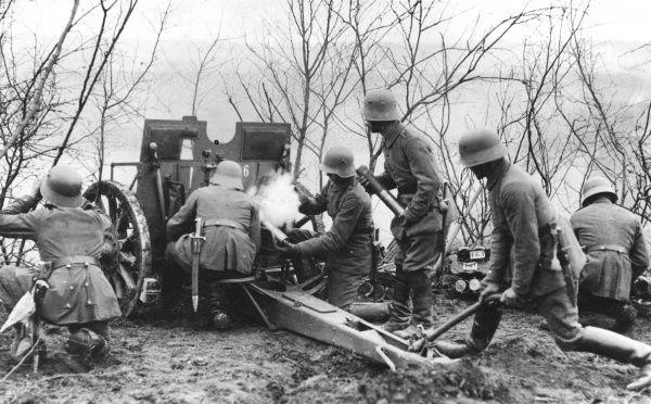 German gunners, loading a field gun during action in the Champagne area of France during the First World War. Date: 1914-1918