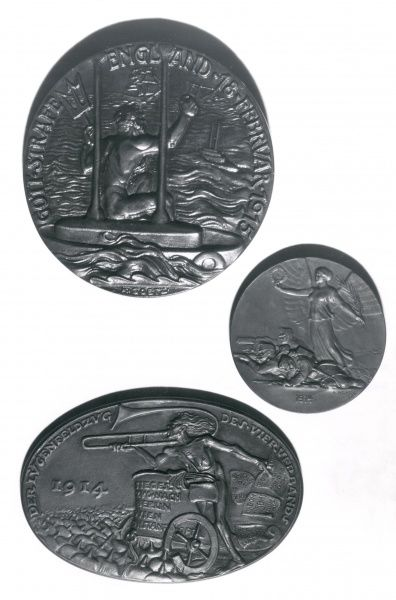 Three German medallions from the First World War. At the top is a large round medallion bearing the words: Gott Strafe England (May God Punish England) 18 Februar 1915, with Neptune sitting on a submarine, watching a sinking ship and shaking his fist