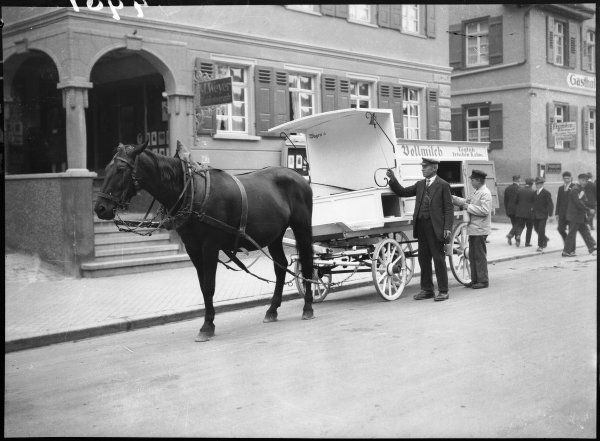 German milkmen loading their horses and carts