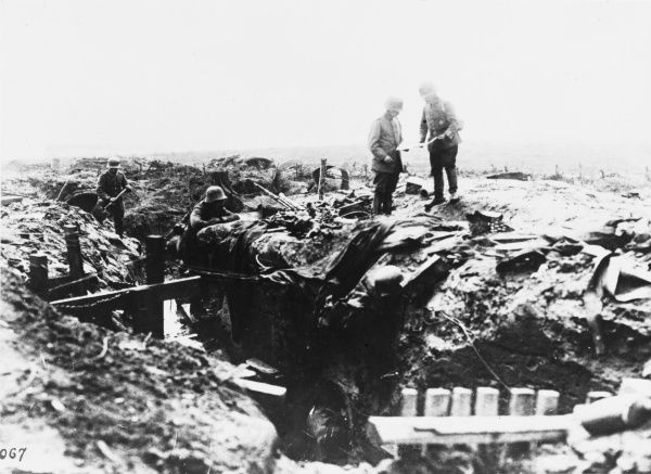 German soldiers exploring captured British trenches and elephant-back dugouts in the Ypres Salient during World War I in Belgium