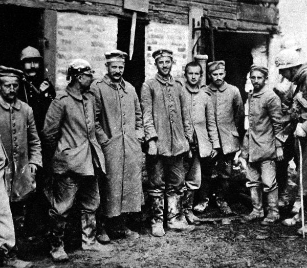 German prisoners, including one wearing a 'pickelhaube' - the German spiked helmet, taken by French soldiers in September 1915
