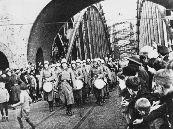German troops march across the Sudendorff Bridge during the German re-occupation of Rhineland, 1936