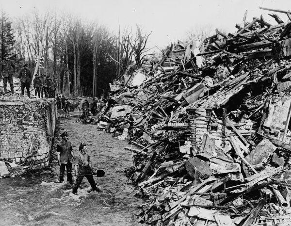 British soldiers clearing a stream of rubble in the River Omignon at Caulaincourt Chateau after the German retreat at the Hindenburg Line on the Western Front in France during World War I in April 1917
