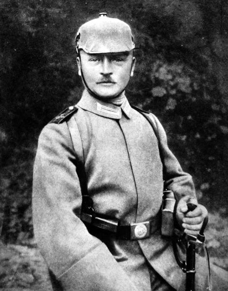German soldier wearing the newly-issued field-grey buttonless uniform with spikeless helmet