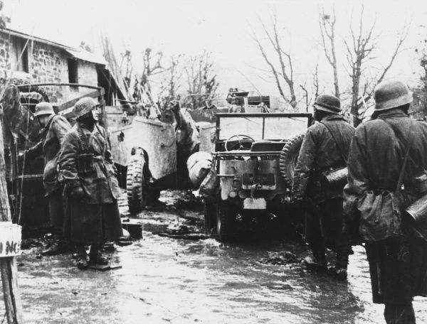 German soldiers look at captured American vehicles on the Western Front during World War II