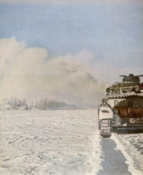 A German tank in the snow- covered Russian countryside. The caption claims that the Germans are successful in all weathers, but events were to prove otherwise