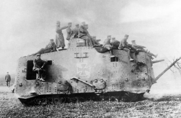 A German tank with soldiers riding on the outside, on the Western Front during the First World War. Date: 1914-1918