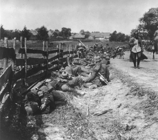 During a pause in the advance through Poland, German troops take the opportunity to get some sleep, by the side of a road