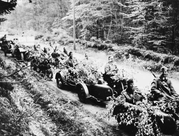 German anti-tank company en route for the front in France, camouflaged against air attack