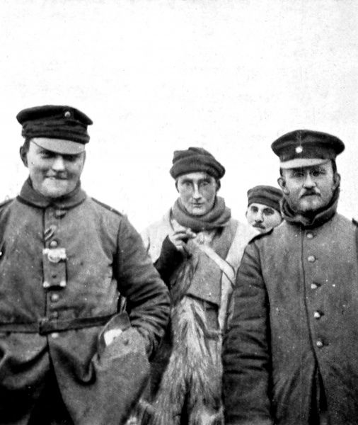 A British soldier fraternising with three Germans during a cease-fire on Christmas Day 1914 during World War I