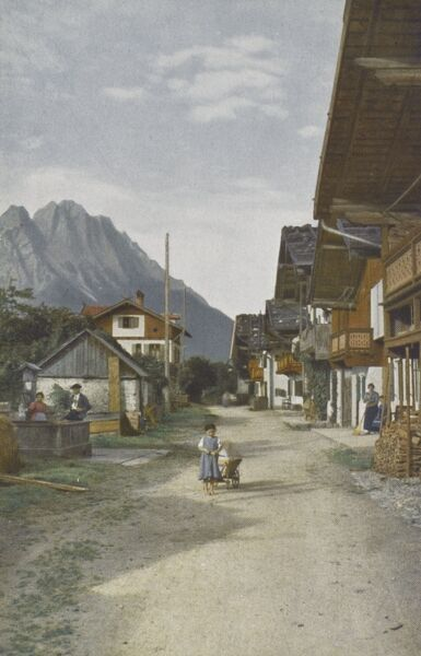 Germany - Garmisch-Partenkirchen - Fruhlingstrasse with a view of the Zugspitze Mountain Date: circa 1910s