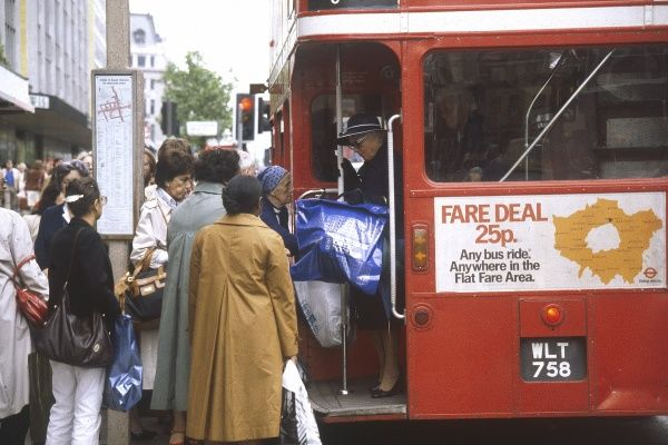 A mad scramble to get onto a London 'Routemaster' bus! Date: 1981