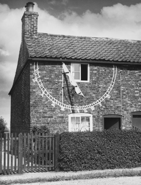 A giant sundial, looking almost like a modern day satellite dish, on the outside of a private cottage at Seaton Ross, Yorkshire