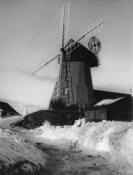 Winter snow at Gibraltar Mill, Great Bardfield, Essex, England. Built as a smock mill c. 1704-5 (during the Siege of Gibraltar), then raised as a tower mill in the 1750s. Date: 18th century