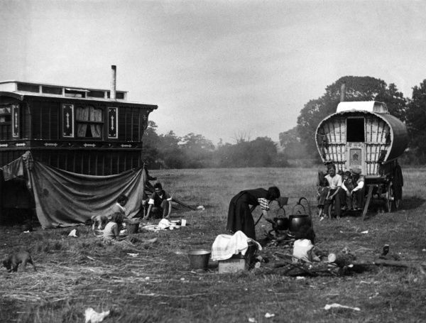 Mealtime on a gipsy encampment, England. Date: 1930s