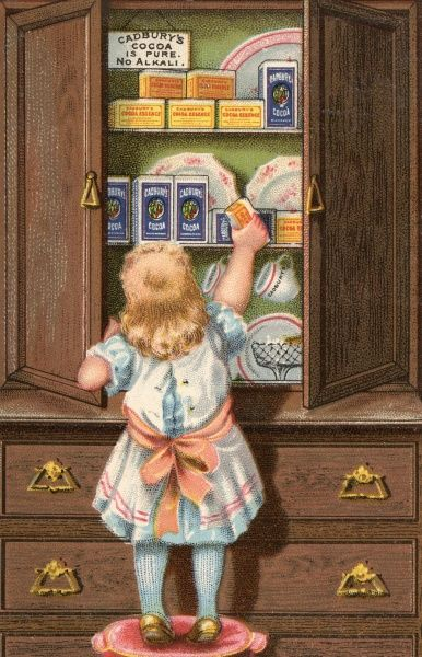 A small girl stands on a stool to help herself to Cadbury's Cocoa from the cupboard. Date: 1890s