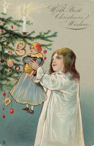 A girl in her nightie gives her doll a close-up view of the nice things on the Christmas Tree