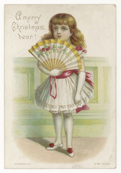 Girl in a white party dress with a pink sash, broderie Anglaise trimmed drawers, long gloves, shoes with rosettes & a folding fan decorated with roses
