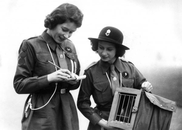 Princess Elizabeth, patrol leader in the Buckingham Palace Company, sends a message by courier pigeon to Lady Baden Powell at Guide Headquarters