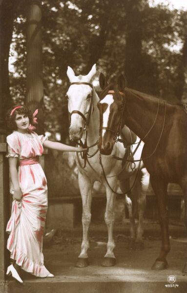 Girl with a pair of horses Date: circa 1910s
