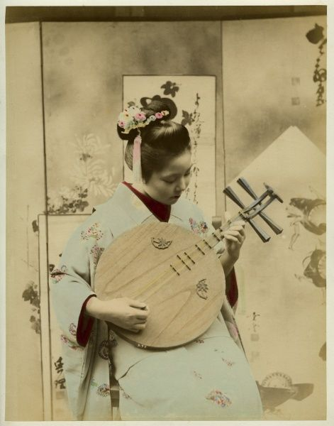 A young Japanese woman with ribboned hair playing a stringed musical instrument, perhaps a version of a lute