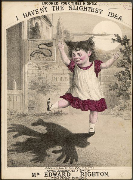 A mischievous-looking little girl plays at shadows