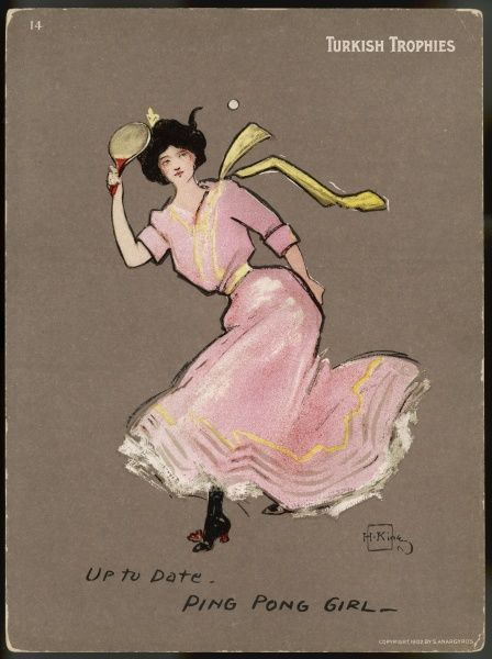 A girl in a flowing pink dress plays ping pong