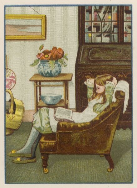 A girl reads a book in the sitting room