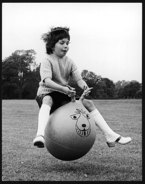 A young girl bounds along in classic bouncing fashion on her splendid spacehopper. (Picture 1 of 4)