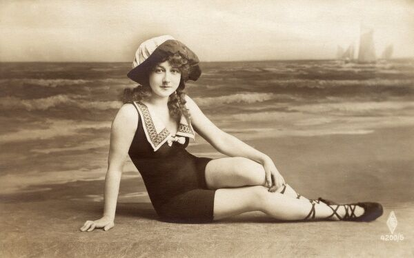 Girl in a rather splendid swimming costume Date: circa 1910s
